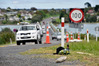 A bottle, flowers and hat mark the spot on SH29a near Maungatapu Bridge where Calum Gilmour, 18, was killed. NZTA are installing a new safety barrier in reduce the risk of head-on crashes. Photo/file