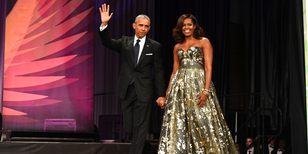 Former president Barack Obama and Michelle Obama are America's new sweethearts. Photo / AP