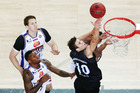 Tom Abercrombie of the Breakers scores on a layup Brisbane Bullets. Photo/Getty Images