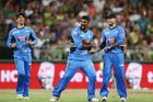 Ish Sodhi of the Adelaide Strikers celebrates with team-mates after taking the wicket against Sydney Thunder. Photo/AP Photos
