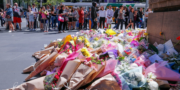 Mourners leave flowers and tributes to the victims of the Melbourne incident. Five people, including a three-month-old baby boy, have now died. Photo / AP