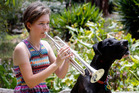 When Megan Burns plays the trumpet her biggest fan Ash, the Great Dane dog, likes to sing along. Photo / John Stone