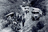 All hands were needed to haul back vehicles which left boggy Northland roads during the 1917 tour.