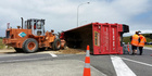 Large truck rolls over at roundabout