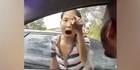 Watch: Watch: Woman bangs on car and racially attacks Muslim woman