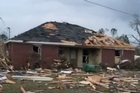 Authorities in Mississippi said four people died when a tornado touched down early Saturday in the area around Hattiesburg. Mississippi's Governor says the storm cut a path that was as much as 25 miles long and a half a mile wide.
