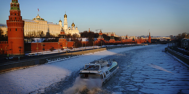 An icebreaking river boat steams past the Kremlin along the Moscow River. Photo / Washington Post