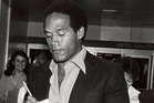 O.J. Simpson (with his son Jason, right) signs autographs at Buffalo International Airport in 1980. Photo / Mickey Osterreicher, courtesy of ESPN Films