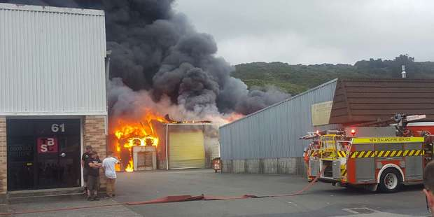 Loading Firefighters battling the blaze at the scene in Upper Hutt. Photo / Frances Cook