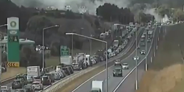 Video from the New Zealand Transport Agency shows plumes of black smoke billowing from the burning vehicle as motorists heading south. Photo / NZTA