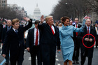 The Secret Service agent's appears to be holding his hands in a distinctive pose as he escorts President Trump and the First Lady down Pennsylvania Avenue. Photo / AP