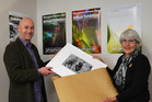 Ken Graham receives a photograph for display in the exhibition from Jacqui McGowan.