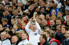 An English fan holds up a replica of the World Cup trophy at Wembley stadium. Photo / AP