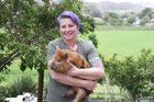Donna Badorek and her beloved kunikuni pigs, including three-month-old Tonka, are looking for a new home.