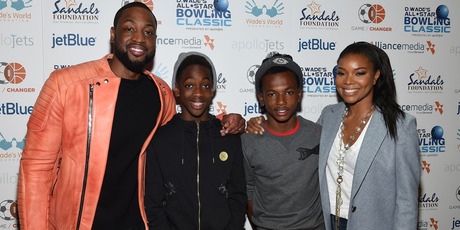 (L-R) Dwyane Wade, Zaire Wade, Dahveon Morris, and Gabrielle Union attend Dwyane Wade's All-Star Bowling Classic hosted by the Sandals Foundation on February 14, 2015. Photo / Getty