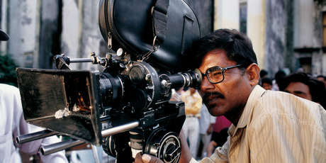 A camera operator on the set of a Bollywood film being shot at Film City January 1997 in Mumbai, India. Photo / Getty