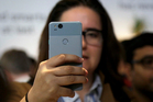 A woman looks at a Google Pixel 2 phone at a Google event at the SFJAZZ Center in San Francisco today. Photo / AP