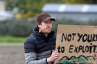 Stefan Tupper, the sole protestor holding a sign saying 'not yours to exploit' at the Tractor rally opposing the WCO (Water Conservation Order) last month. Photo/ Duncan Brown