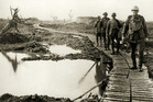 Soldiers use board walks at Passchendaele, near Flanders, in a temporary respite from the mud-choked desolation of the battleground. Photo / RSA