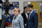 German Chancellor and Christian Democrat (CDU) Angela Merkel arrives to give a statement to the media after the CDU won 32.9 per cent of the vote in the German federal elections on September 25.