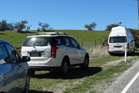People are continuing to park alongside Mt Aspiring Rd near the entrance to the Roys Peak track so they can hike the popular walk, despite it being closed until early next month. Photo / Kerrie Waterworth