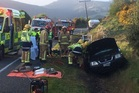 SH1 is blocked after a crash between an LPG carrier and light 4WD. Photo / Stephen Jaquiery, Otago Daily Times