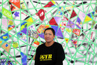 Stormie Hunter-Rogan from Nga Tai O Te Awa  standing next to the paint a patch five ways to well-being art display. Photo/ Stuart Munro