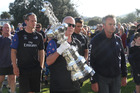 Official Cup minder Norm Newton delivering the Auld Mug to the fans at Taipa.