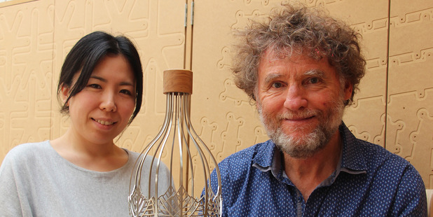 Hawke's Bay A and P Bayleys Wine Awards trophy designers Makiko Smith and David Trubridge holding this year's trophy design. Photo/ supplied.