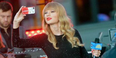 Taylor Swift takes a photo on her phone on Good Morning America. Photo / Getty