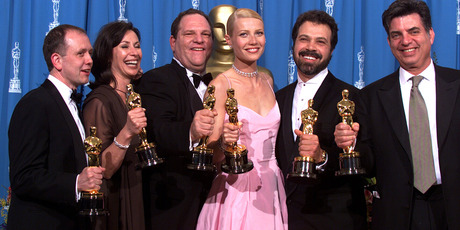 Shakespeare in Love Best Actress winner Gwyneth Paltrow (center) is joined by Harvey Weinstein (center left). Photo / Getty