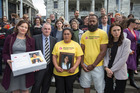 Hastings mum Hana Reedy (with daughter Ariana's photo) and husband Apimeleki Nasedra at Parliament with Green MP Julie Anne Genter, left, Labour MP Trevor Mallard and Labour leader Jacinda Ardern. Photo / Mark Mitchell