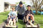 Menzshed member Bill Were with 9-year-old Liam Arthur (left) and Ben Monkley, 13.