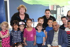 Kapiti Mayor K Gurunathan with staff and some of the children at Community Kindy Bluegum, Paraparaumu Beach.