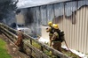 Firefighters douse a blaze at a shed packed with sound and musical equipment which was destroyed by fire in Kerikeri.