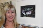 Julie Freeman with her award winning artwork On Guard.