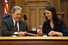 NZ First leader Winston Peters and incoming Prime Minister Jacinda Ardern signing their coalition agreement at Parliament. Photo / Mark Mitchell