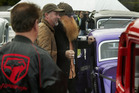 Club president Geoff Mitford-Taylor shows ZZ Top's bearded Billy Gibbons some of the rods at the 2009 festival. HBT091907-03.