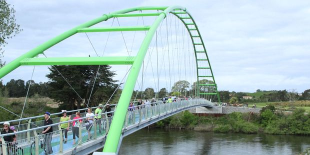 The first cyclists and walkers  on the Perry Bridge after it was opened on Thursday  at Horotiu. The bridge will offer a connection between the future Te Awa Lakes development site and the Te Awa Cycleway. Photo / Tom Rowland