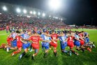 Players from Tonga and Samoa join in a prayer at Waikato Stadium after their match last week. PHOTO/PHOTOSPORT