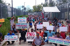 Refugees and asylum seekers hold up banners during a protest at the Manus Island immigration detention centre in Papua New Guinea. Photo / AP