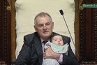 Parliament TV shows Trevor Mallard holding Willow-Jean Prime's daughter, Heeni, 3 months. Photo / Mark Mitchell