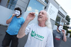 Pro-cannabis activist Brian Thomas Borland of the Daktory Social Club openly smoking cannabis outside the Whangarei law courts. Photo / Michael Cunningham