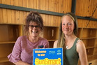 Cancer Society health promoter Judy McIntyre presenting the sun smart plaque to senior student Paige Cromarty.