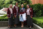 GIFT: Kapa haka members Farren McGregor-Smyth (left), Angel Hillman and Montana Porima, with Woodford House principal Julie Peterson after she officially received the korowai gift.