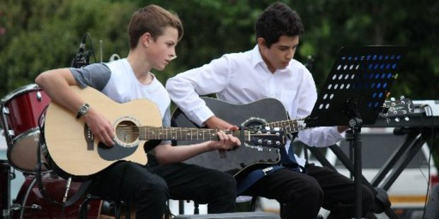 Two students from Rototuna High School and Melville High school performed a guitar duet to welcome the crowd to Ngaruawahia golf course. Photo / Tom Rowland