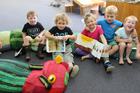 Avon Kindergarten children Rex Rooney, Matheus Hamill, Harmony Leigh, Oscar Trenary and Beauden Dudley think the caterpillar is pretty comfortable.