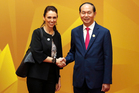 Vietnam's President Tran Dai Quang, right, shakes hands with New Zealand's Prime Minister Jacinda Ardern at the APEC Economic Leaders' Meeting in Danang. Photo / AP