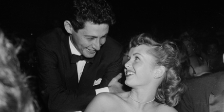 1954: Singer Eddie Fisher talks with actress Debbie Reynolds between performances at the Cocoanut Grove. Photo / Getty