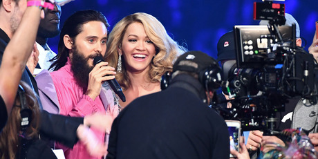 Host Rita Ora speaks to Jared Leto of Thirty Seconds to Mars after the band won the award for Best Alternative on stage during the MTV EMAs 2017. Photo / Getty